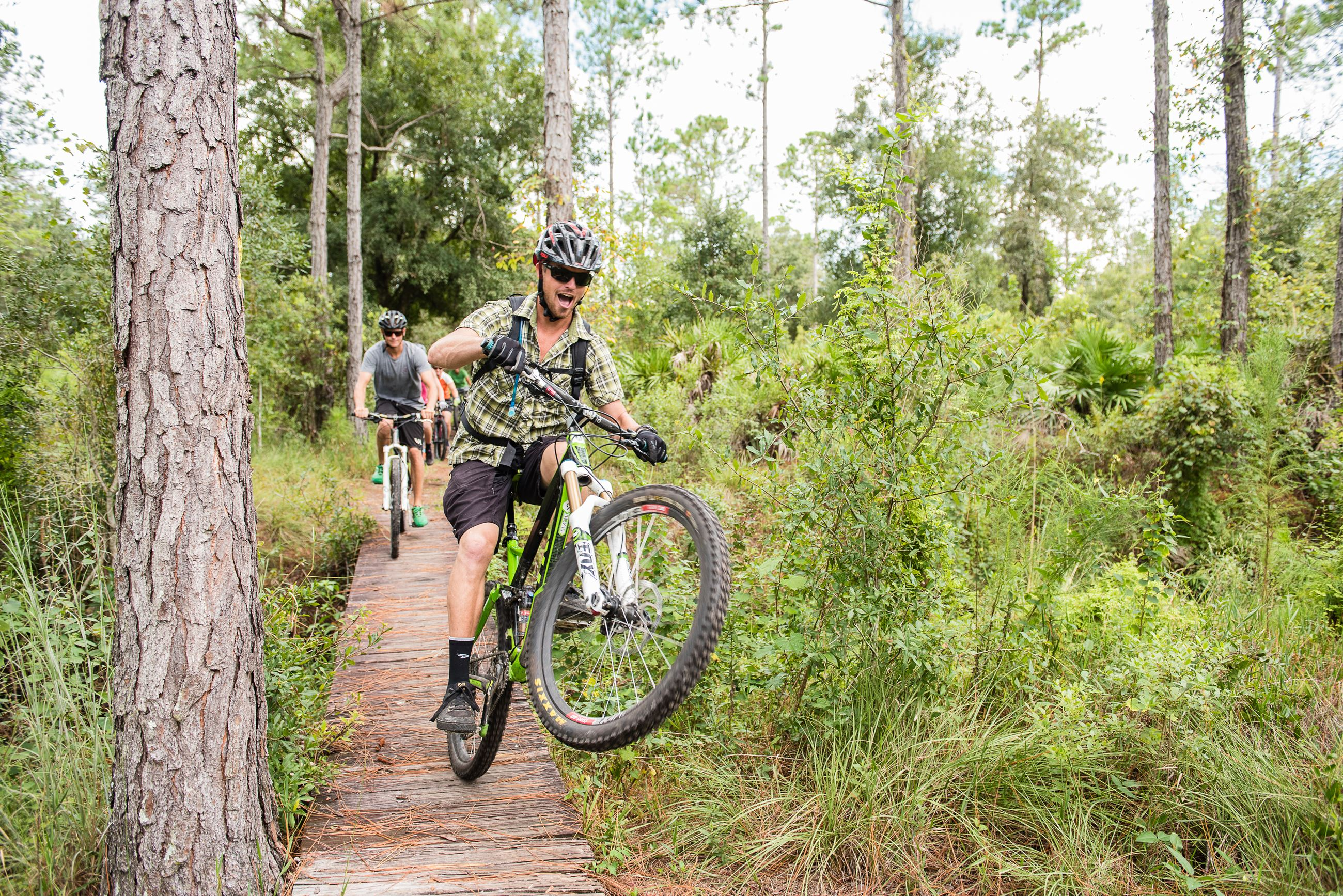 Image of a bicyclist enjoying the Preserve trail at Sun 'n Lake